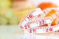 Weight watcher - Measuring tape with different fruits Stock Photos