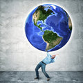 Weight of the world floating globe and businessman Royalty Free Stock Photos