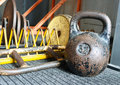 Weight worn near other equipment for force development blur background Royalty Free Stock Photo