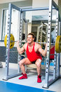 Weightlifter squats with a barbell Royalty Free Stock Photography