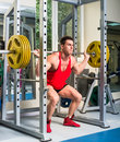Weightlifter squats with a barbell Stock Image