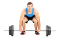 Weightlifting athlete lifting a barbell isolated on white background Stock Photography