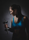 Weightlifting young woman wearing sportswear and she exercise studio shot dark background Royalty Free Stock Images