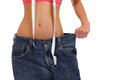 Weightloss - woman showing loss of weight on white Royalty Free Stock Images