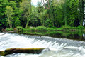 Weir on the river liffey in the k club in county kildare ireland Royalty Free Stock Images