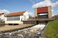 Weir with running water spill and pump house at sluice complex the netherlands Stock Photography