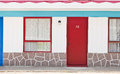 Motel with red and blue doors Royalty Free Stock Photo