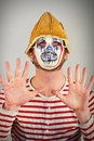 Weird scary mime masked in striped red and white shirt Stock Photo
