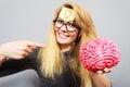 Weird woman holding brain having idea Royalty Free Stock Photo