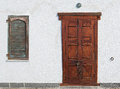 Weird wooden door and old window with shutters Royalty Free Stock Image