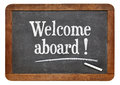 Welcome aboard blackboard sign white chalk text on a vintage slate Stock Images