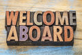 Welcome aboard in wood type sign vintage letterpress blocks stained by color inks Stock Photos
