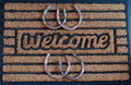 Welcome door mat with horseshoes a implying horses funny horse removing shoes before entering stable etc Stock Image