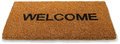 Welcome front door mat isolated white Stock Photos