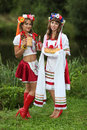 Welcome guest two girls in ukrainian costumes on the banks of the river with bread and vodka dressed up for the holiday of ivan Royalty Free Stock Photos