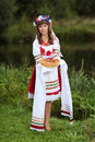 Welcome guest ukrainian girl in national clothes meets guests with handmade bread Stock Images