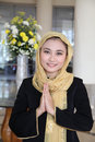 Welcome gusture from asian muslim Stock Photo