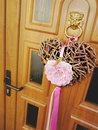Welcome handmade heart made of many little wooden sticks hanging on the main door to visits Stock Image