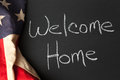 Welcome home sign for troops with american flag on a chalkboard Royalty Free Stock Images