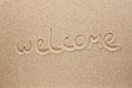 Welcome is the inscription by hand on the sand