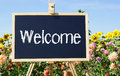 Welcome sign in garden Stock Photo