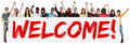 Welcome sign group of young multi ethnic people holding banner Royalty Free Stock Photo