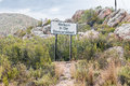 Welcome sign at the start of a wet baviaanskloof western entrance and gloomy baboon valley during rain storm Stock Photo
