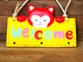 Welcome sign on wooden background Royalty Free Stock Photo
