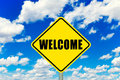 Welcome sign yellow road with clouds and sky in background Royalty Free Stock Images
