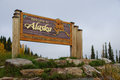 Welcome to alaska sign on highway at the united states canada border Royalty Free Stock Image