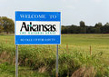 Welcome to arkansas maysville usa – october a sign marks the state line between and oklahoma on sr known as Stock Image