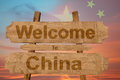 Welcome to China sing on wood background with blending national flag Royalty Free Stock Photo