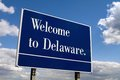 Welcome to delaware sign on the state live against a cloudy blue sky Stock Images