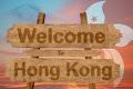 Welcome to Hong Kong sign on wood background with blending national flag Royalty Free Stock Photo