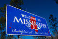 Welcome to mississippi state road sign with a blue sky background Royalty Free Stock Image