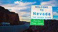 Welcome to nevada state border sign with clouds and a blue sky in the background Royalty Free Stock Images