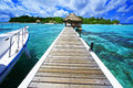 Welcome to paradise landing stage at eriyadu island resort in north male atoll maldives Royalty Free Stock Photo