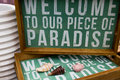 Welcome to paradise our piece of sign and home décor for cottage or seasonal home Royalty Free Stock Images