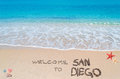 Welcome to san diego turquoise water and golden sand with shells and sea stars with written on it Stock Photos