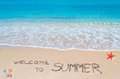 Welcome to summer turquoise water and golden sand with written on it Royalty Free Stock Photos