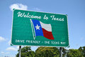Welcome to texas road sign a set against a light blue background showing the state flag Stock Images