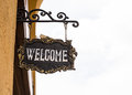 Welcome wooden sign board with rope hanging in front of the gate Royalty Free Stock Photo