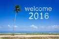 Welcome 2016 word cloud in blue sky at tropical beach
