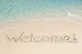 Welcome written on sand by sea Royalty Free Stock Photo