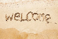 Welcome written in a sandy beach tropical Royalty Free Stock Photos