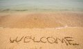 Welcome written in a sandy beach tropical Royalty Free Stock Image