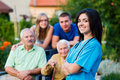 Welcoming nursing home carer confident and kind doctor the family members of the elderly patient Royalty Free Stock Photos