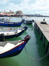 The weld quay penang malaysia fishing boats parked by jetty at Royalty Free Stock Photography