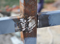 stock image of  Weld on a Steel Iron Bar for a New Fence Frame.