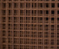 Welded wire mesh rusted stacked creating abstract industrial background Stock Images